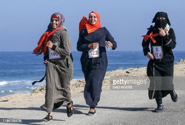 Palestinian women take part in a marathon calling for an end to violence against women, in Khan Yunis in the southern Gaza Strip on December 1, 2019.