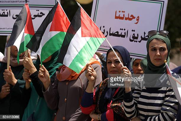 Palestinian women take part in a protest calling for an end to political division outside the Palestinian Legislative Council in Gaza City on 26...