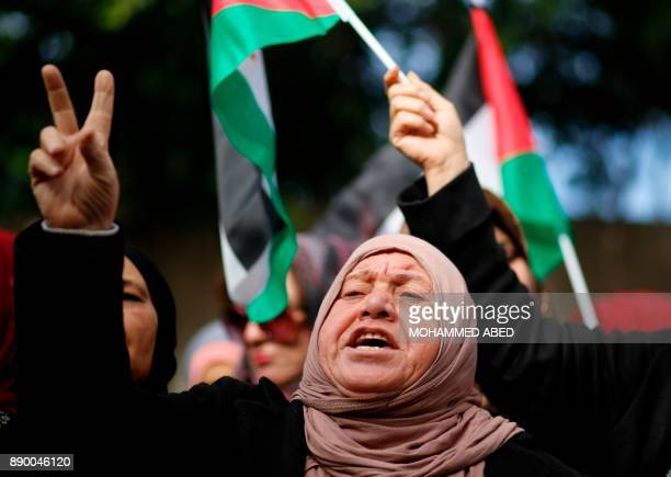 Palestinian women take part in a protest next to the offices of UNSCO against US President Donald Trump's decision to recognise Jerusalem as the...