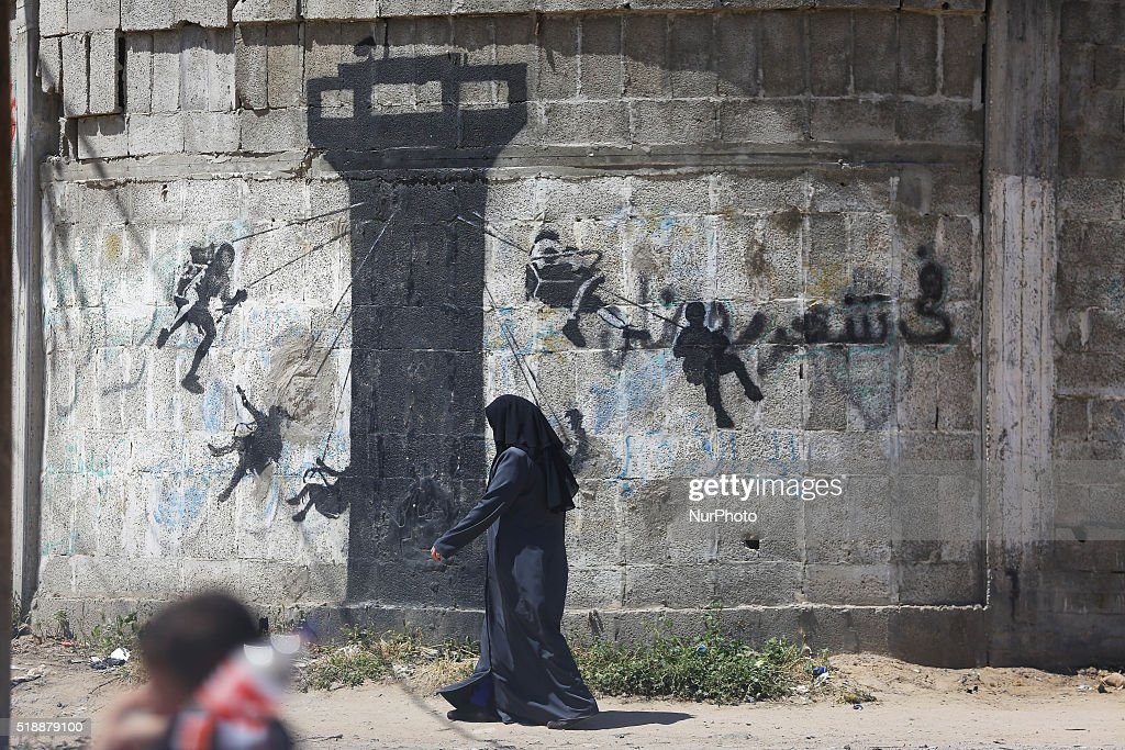 Artist  Banksy painted on the remains of houses destroyed in Gaza : News Photo