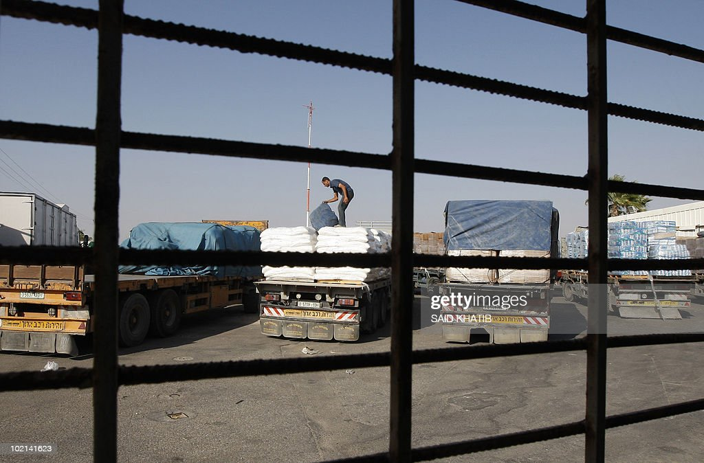 A Palestinian worker check a truck carrying supplies after it arrived in Rafah town through the Kerem Shalom crossing between Israel and the southern Gaza Strip on June 16, 2010 as Israel's security cabinet met to consider an international proposal for significantly easing its blockade on Gaza Strip, which has been in place since 2006.