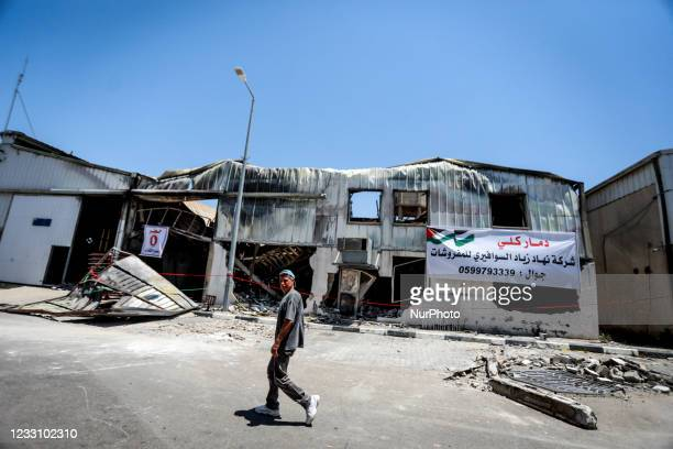 Palestinian worker inspects the damage at a factory in Gaza's industrial area, on May 25 which was hit by Israeli strikes prior to a cease-fire...