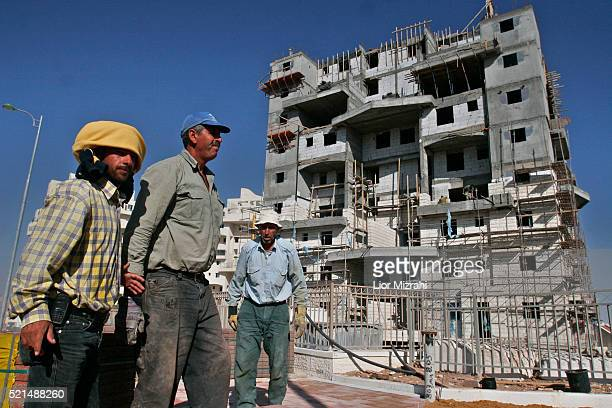 Palestinian workers at a construction site in the West Bank settlement of Maale Adumin Tuesday November 21 2006. A new study conducted by left-wing...