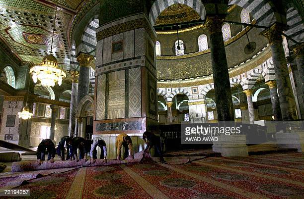 Palestinian workers remove carpets from the Dome of the Rock Mosque in the AlAqsa mosque compound also known to Jews as the Temple Mount in Jerusalem...