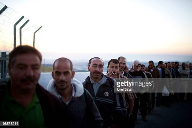 Palestinian workers stand in line to cross into Israel on April 25 2010 at the Olives Crossing in Al Tur West Bank a few kilometers north east of...