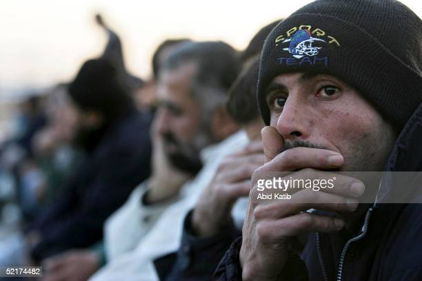 Palestinian workers wait at Erez Chickpoint before entering into the Erez industrial zone on February 10 2005 in northern Gaza Strip The Israeli...