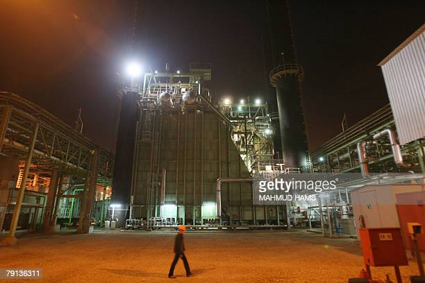 Palestinian workers walks in the Palestinian electricity company AlNuseirat in the central Gaza Strip 20 January 2008 Gaza's only power plant which...