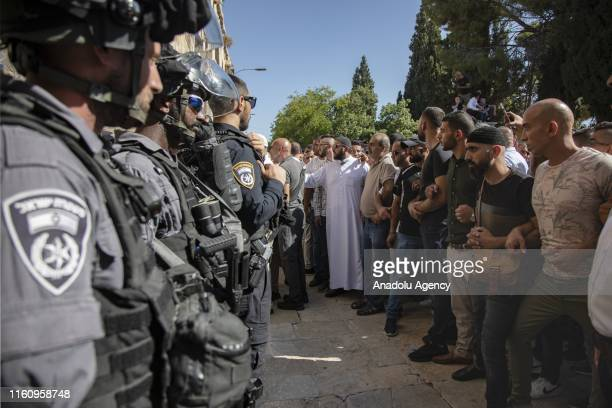 Palestinian worshipers gather in front of the Bab Al Maghrib after Eid alAdha prayer asking Israeli police to not open the gate to fanatic Jews...
