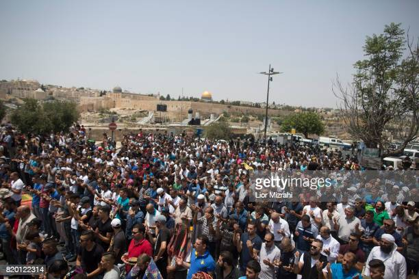 Palestinian worshippers are seen during a pray in Ras elAmud Area outside the Old City on July 21 2017 in Jerusalem Israel Following last Friday...