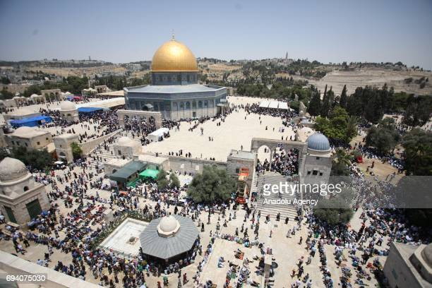 Palestinian worshippers arrive at AlAqsa Mosque to perform the second Friday prayer of the holy fasting month of Ramadan in Jerusalem on June 09 2017