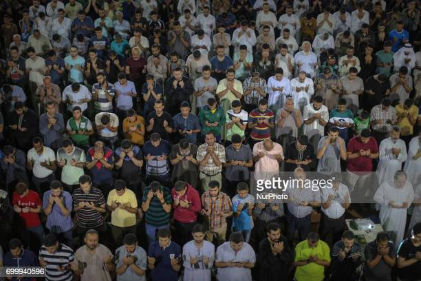 Palestinian worshippers attend a night prayers during Laylat AlQadr at alOmari mosque in Gaza City on June 22 2017 Laylat AlQadr is the night when...