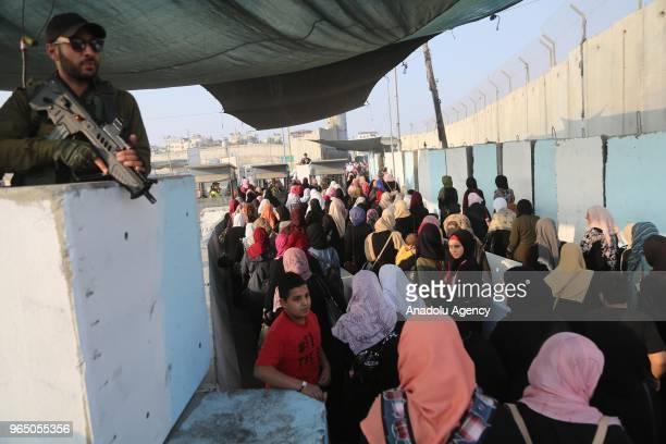 Palestinian worshippers mostly from women wait in a queue to move for passing through the Qalandiya checkpoint from Ramallah into Jerusalem after...
