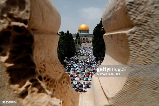 TOPSHOT Palestinian worshippers pray in Jerusalem's AlAqsa Mosque compound on the second Friday prayers of the Muslim holy month of Ramadan on May 25...