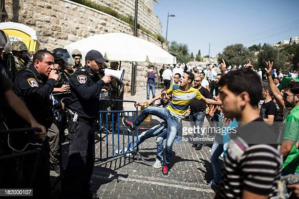 Palestinian youth clash with Police as they march to AlAqsa mosque after friday prayers on September 27 2013 in Jerusalem Israel Police today in...