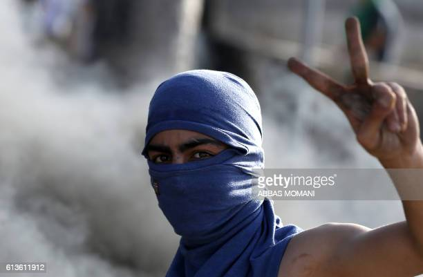 A Palestinian youth gestures during clashes with Israeli security forces in the West Bank town of alRam north of Jerusalem on October 9 2016 A...