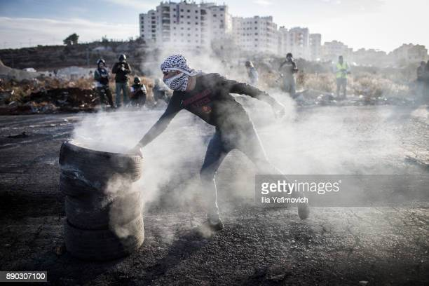 Palestinian youth light tires on fire as they clash with Israeli Defence Forces in the streets on December 11 2017 in North of Ramallah WestBank...