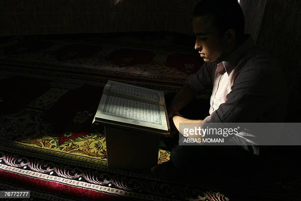 A Palestinian youth reads the Koran at a mosque during the third day of the holy Muslim fasting month of Ramadan in the West Bank city of Ramallah 15...