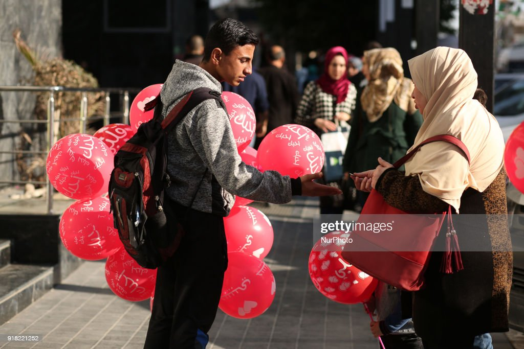 A Palestinian youth sells balloons on Valentine's Day in Gaza City on February 14, 2018.