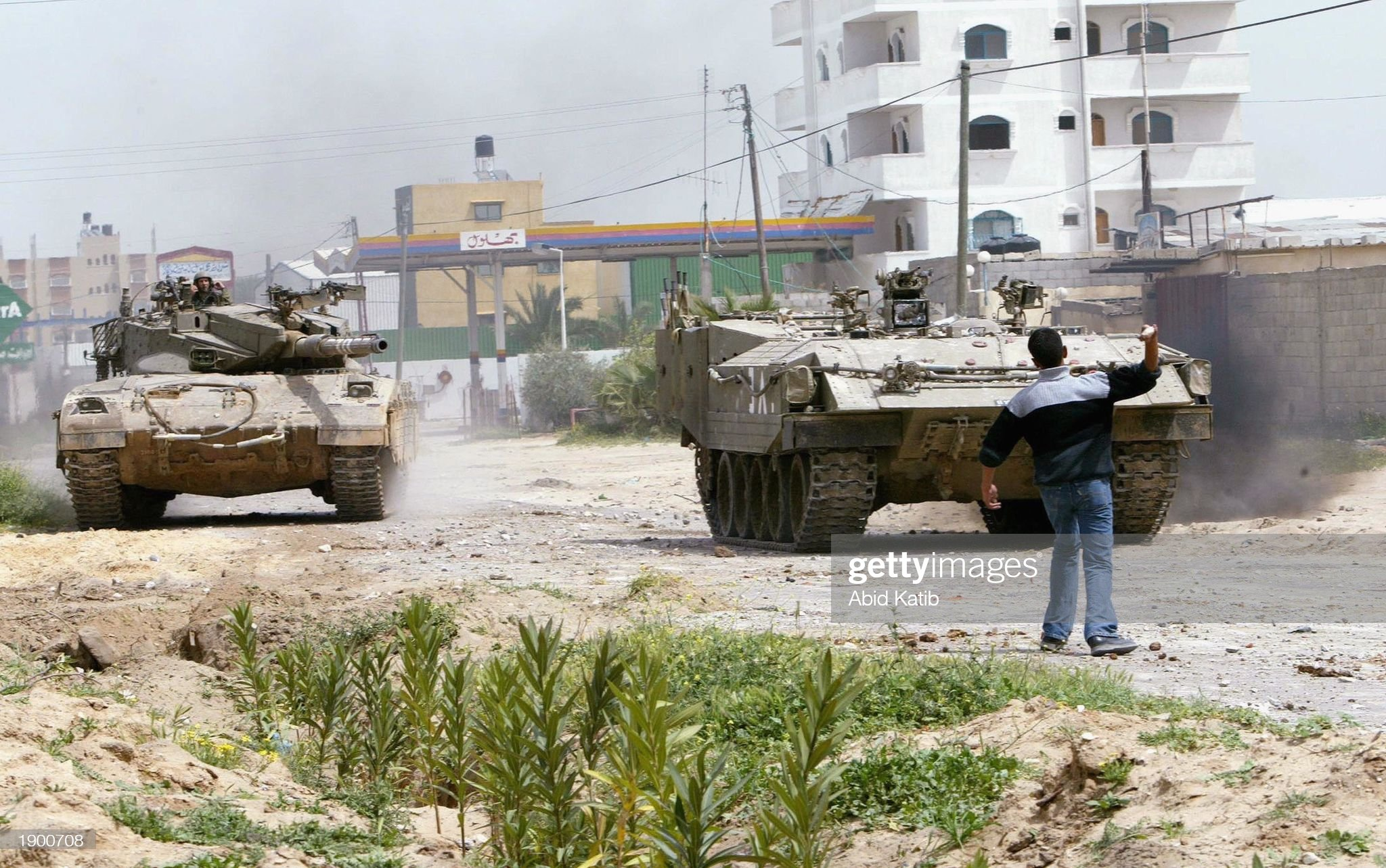 https://media.gettyimages.com/photos/palestinian-youth-throws-stones-at-an-israeli-armored-personnel-and-picture-id1900708?s=2048x2048