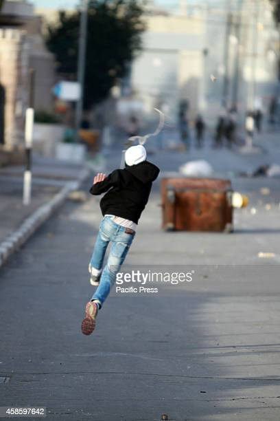 Palestinian youth throws stones to the Israeli armies in Bethlehem Clashes between Palestinian youths and Israeli soldiers at the entrance to the...