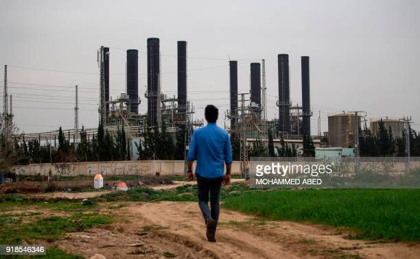 Palestinian youth walks towards the Gaza strip's sole electricity plant which provides a fifth of the embattled region's power needs on February 15...