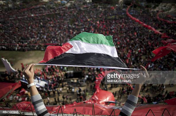 A Palestinian youth waves a national flag during a rally in Gaza City on December 7 marking the 46th anniversary of the founding of the Popular Front...