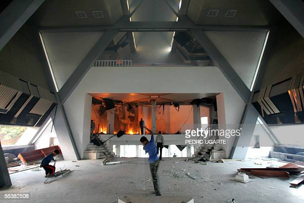 Palestinian youths are seen inside the burning synagogue of the former southern Gaza Strip settlment of Neve Dekalim 12 September 2005 Israel closed...