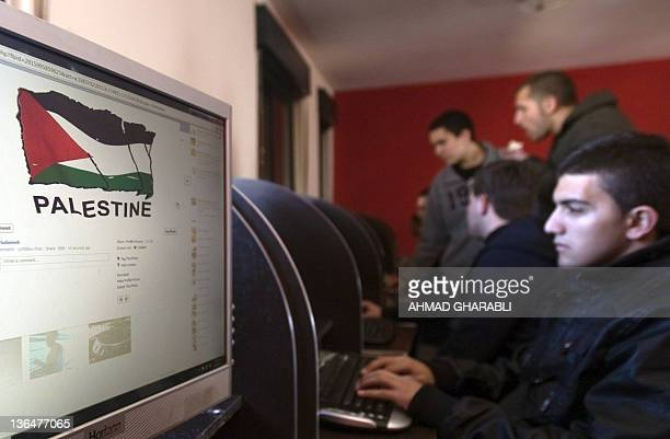 Palestinian youths check their facebook accounts at an internet cafe in the West Bank city of Ramallah on January 6 2012 Inspired by the role of...