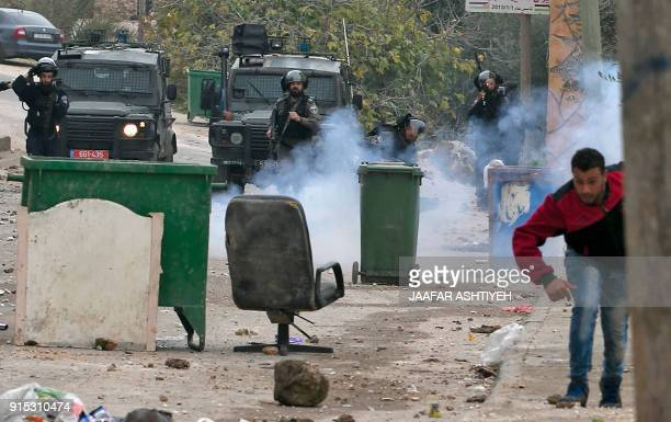 Palestinian youths clash with Israeli forces in the village of alYamun on the outskirts of Jenin in the occupied West Bank on February 6 2018...