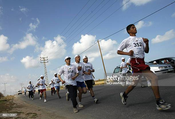 Palestinian youths compete in a marathon organised to mark the Prisoner Day in Gaza City on April 17 2009 Palestinians mark Prisoner Day on March 17...