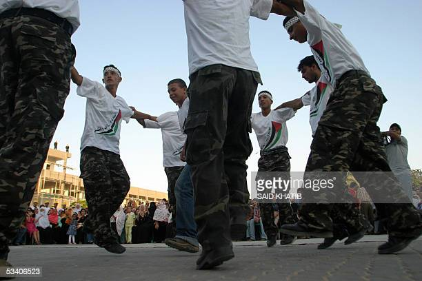 Palestinian youths dance during a group wedding ceremony organized by the mainstream Fatah movement in the southern Gaza Strip town of Khan Yunes 18...