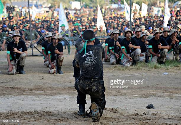 Palestinian youths demonstrate their skills during graduation ceremony of a military-style camp organized by the Hamas movement in Gaza City....