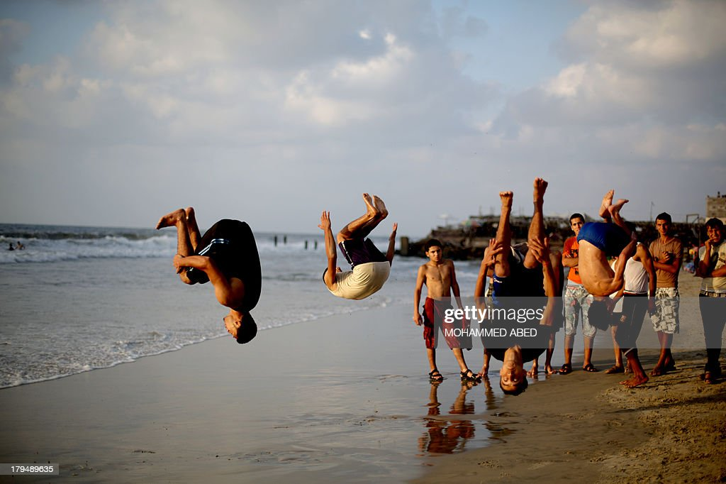c5faa3989 PALESTINIAN-GAZA-YOUTH-DAILYLIFE. Palestinian youths do flips on the beach  in ...