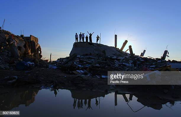 Palestinian youths practicing Parkour skills on the ruins of the houses that were destroyed during the Israeli attack at the east of Khan Yunis in...