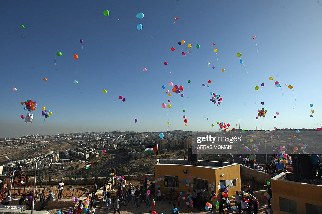 Palestinian youths release with foreign peace activists, including Israeli leftists, more than 3,000 balloons in the sky across Israel's separation barrier above the settlement of Givat Zeev during a Nakba rally in the West Bank town of al-Ram, on the outskirts of Jerusalem, on May 6, 2010. The Palestinians mark on May 15 the 'Nakba', or 'Catastrophe', which commemorates the expulsion and fleeing of hundreds of thousands of Palestinians from British-mandate Palestine as a result of the 1948 war that led to the creation of the state of Israel.