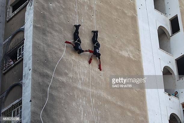Palestinian youths show their skills during a graduation ceremony as part of a military-style summer camp organised by the Ezzedine al-Qassam...