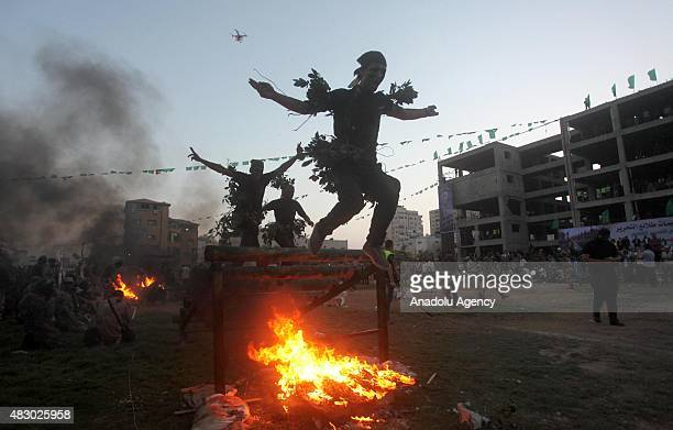 Palestinian youths show their skills during a graduation ceremony of the Hamas' military summer camp in Gaza City on August 05 2015