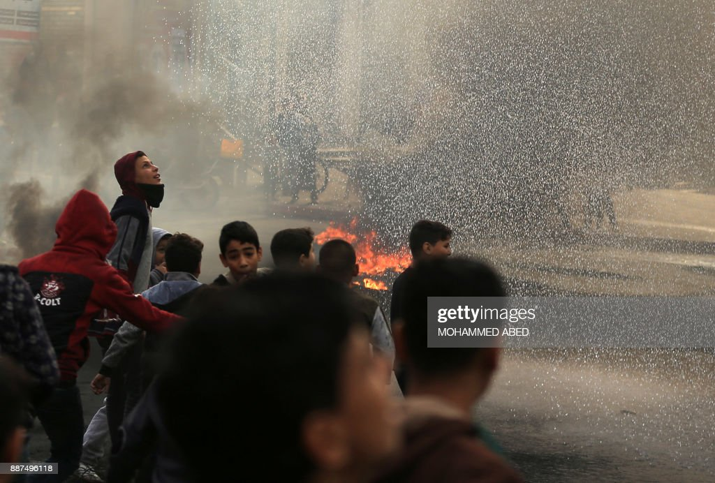Palestinian youths take part in a protest against US President Donald Trump's decision to recognise Jerusalem as the capital of Israel, in Gaza City, on December 7, 2017. /