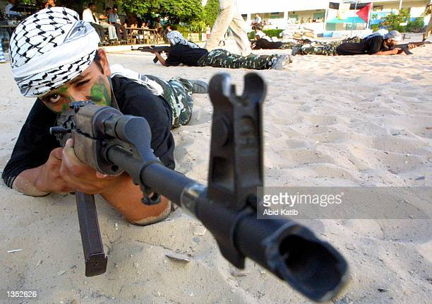 Palestinian youths take part in militant training August 24, 2002 in Rafah refugee camp, the Gaza Strip. An agreement to ease Israel's military...