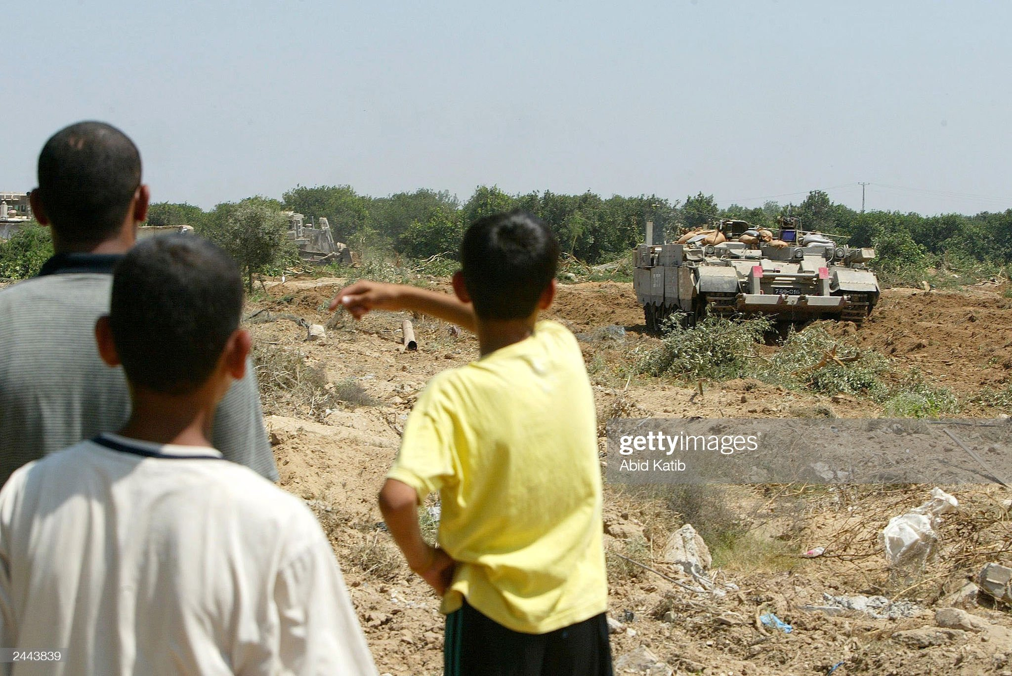 https://media.gettyimages.com/photos/palestinian-youths-watch-as-israeli-tanks-and-bulldozers-destroy-picture-id2443839?s=2048x2048
