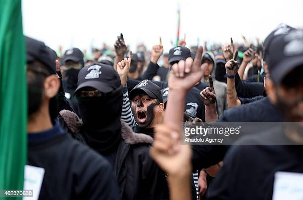 Palestinian youths who attend a military style training camp of Ezzedin alQassam Brigades the armed wing of Hamas movement chant slogans during a...