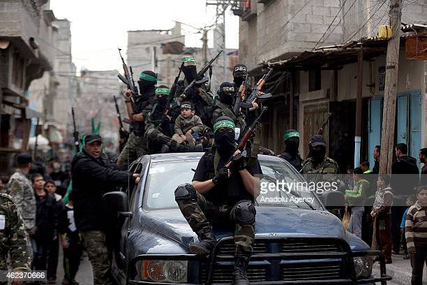 Palestinian youths who attend a military style training camp of Ezzedin alQassam Brigades the armed wing of Hamas movement take part in a military...