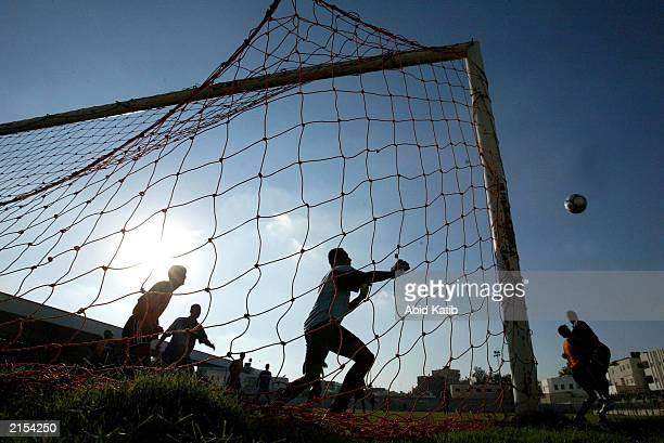 Palestinian Zawaideh soccer club goalkeeper tries to catch the ball as he plays against the Palestinian Shabab Rafah soccer club July 11, 2003 in...