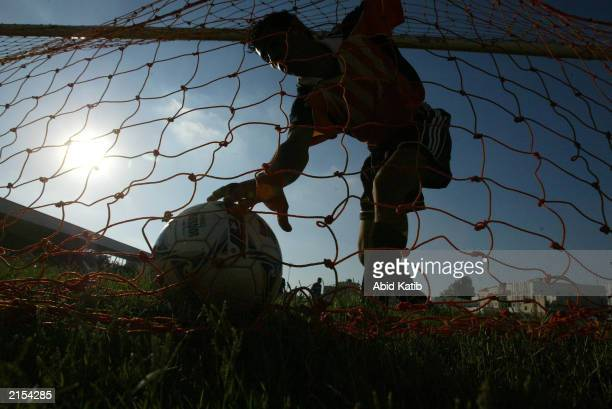 Palestinian Zawaideh soccer club player grabs the ball after a score was made by the players of the Palestinian Shabab Rafah soccer club July 11,...