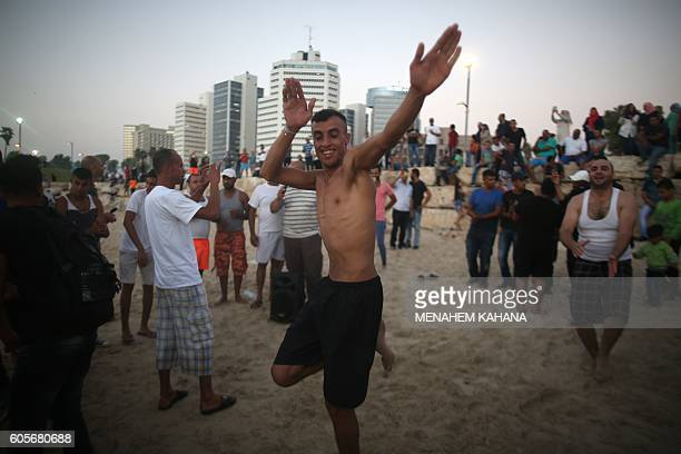 Palestinians and IsraeliArabs dance at the beach in Tel Aviv during the three day Eid alAdha Muslim holiday on September 14 2016 Thousands of...