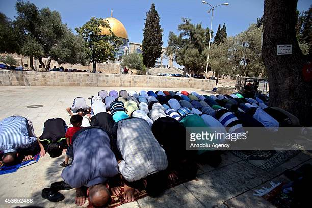 Palestinians and Muslim tourists perform friday prayer in AlAqsa Mosque after Israeli forces let Muslims to enter AlAqsa Mosque from all age for...
