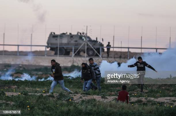 Palestinians are affected by tear gas after Israeli forces' intervention during a protest within Great March of Return demonstrations in Khan Yunis...