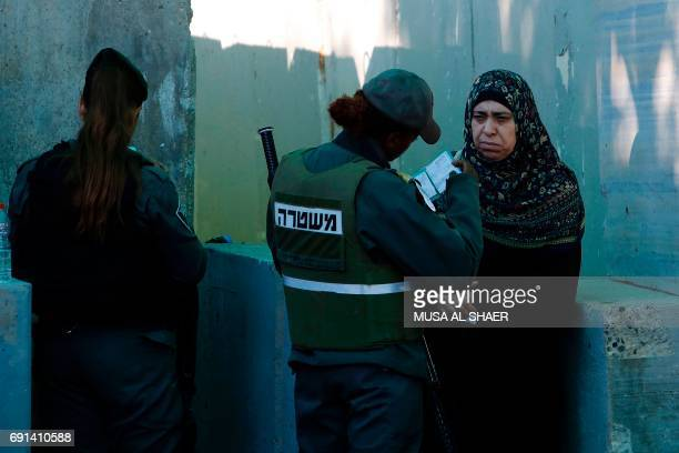 Palestinians are checked at an Israeli checkpoint between the West Bank town of Bethlehem and Jerusalem as they head to Jerusalem's AlAqsa Mosque...