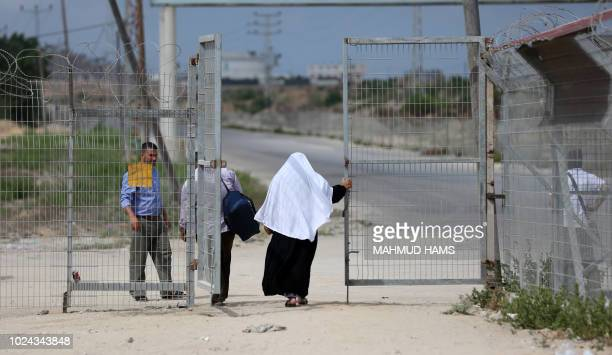 Palestinians are seen crossing at the Erez crossing with Israel near Beit Hanun in the northern Gaza Strip on August 27 2018 Israel reopened its only...