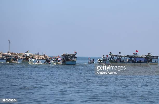 Palestinians are seen on boats to set out from the Gaza Strip on Tuesday in hopes of breaking an 11year Israeli blockade on the coastal enclave in...